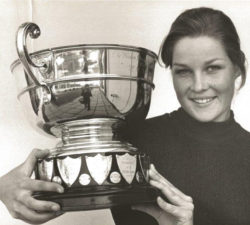 Younger Sally Little posing with her trophy cup