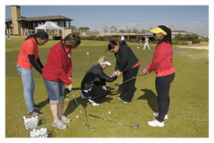 Sally Little helping women with their golf club handling