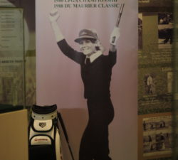 A banner of Sally Little with her golf bag that she used