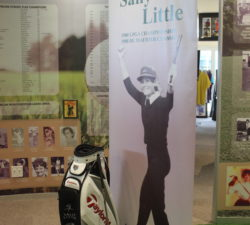 A banner of Sally Little with her golf bag