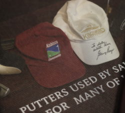 Hats used by Sally Little for various golf games and one hat signed by Gary Player